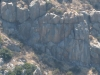 zoom in towards the rockclimbers
