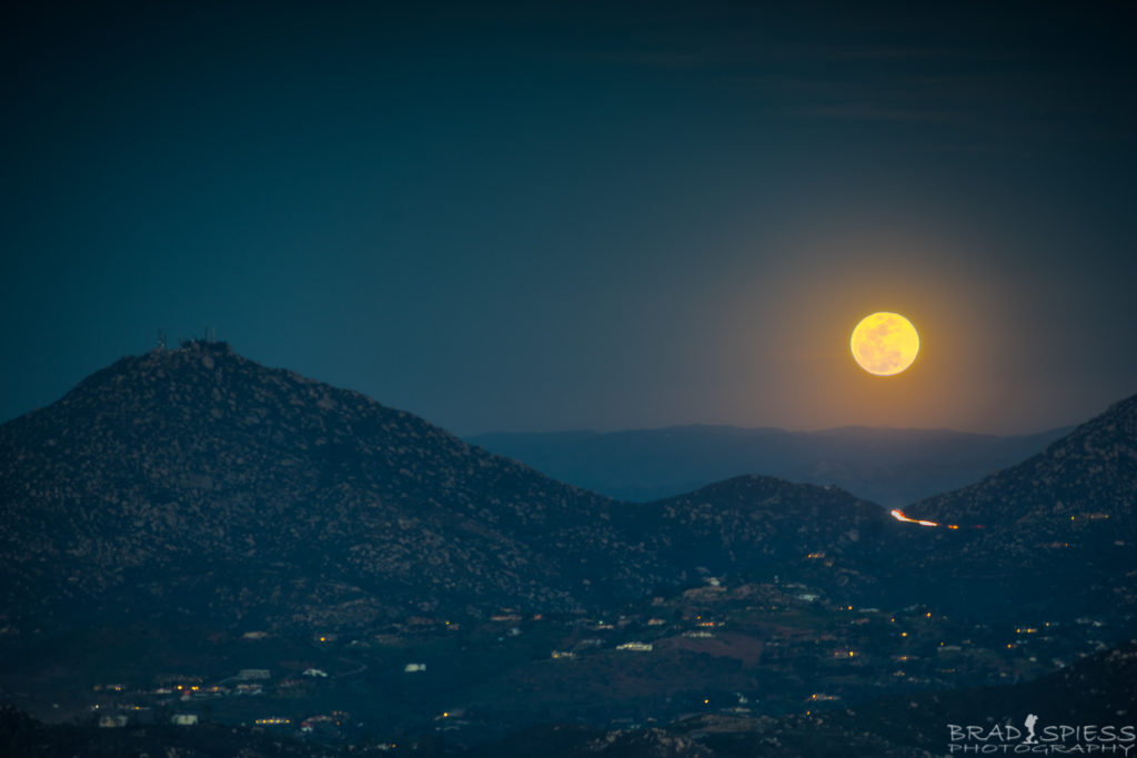 The full moon rising up behind Mt Woodson taken from the top of Black Mountain