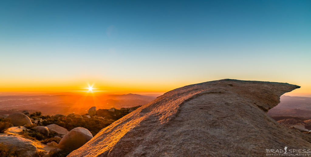 Watching the sunset from Potato Chip Rock on Mt Woodson in San Diego