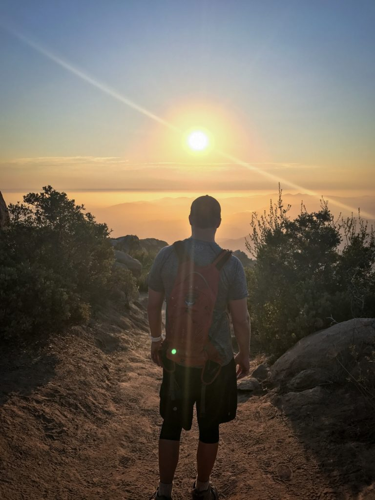 A buddy and I hiking down the Mt Woodson trail to the lake at sunset before we head back up and over to the back at night